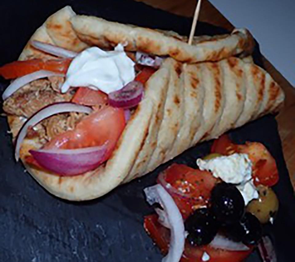 Greek wrap with pork, salad and tzatziki